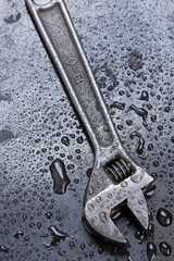 Adjustable spanner in water drops
