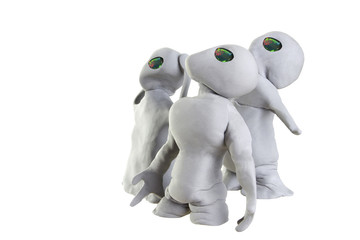 gray alien made of clay on a white background