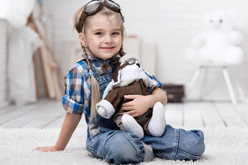Portrait of a little girl with a soft toy