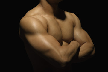 Close-up of a muscular man showing his muscles