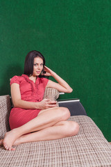brunette red dress sofa