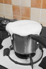 Milk boiling over a pan