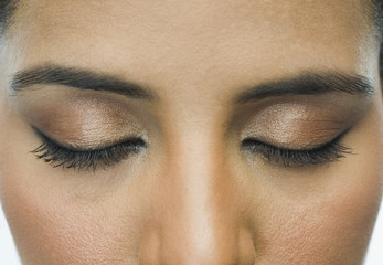 Close-up of a woman with eye make-up