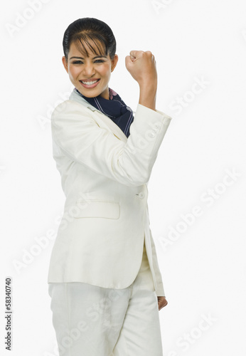 Portrait of a businesswoman clenching fist