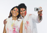 Couple taking a picture of themselves on Holi