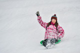 girl sliding in the snow