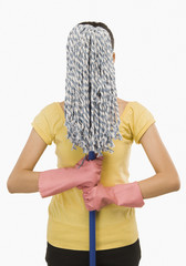 Woman hiding her face with a mop