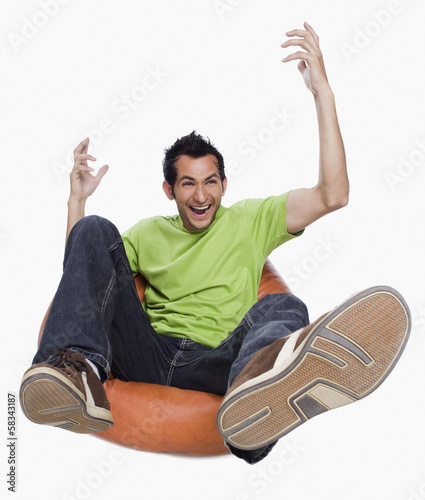 Man cheering on a bean bag