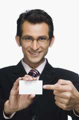 Portrait of a businessman showing a business card