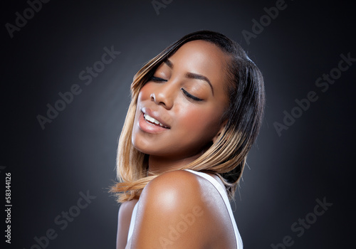 Black beauty with perfect skin smiling
