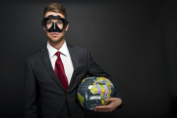 Businessman with world globe and diving mask