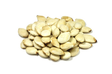 roasted pumpkin seeds on a white background