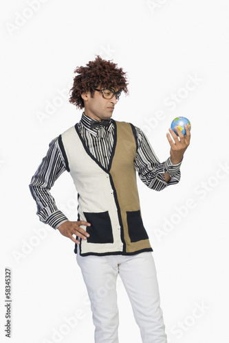Man looking at a globe