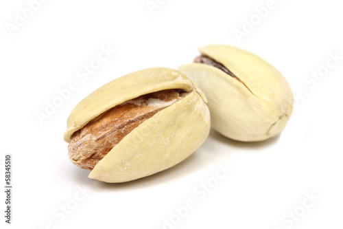 salted pistachio nuts close up on a white background