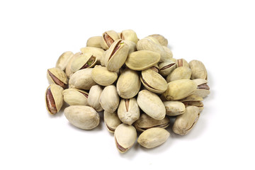 a handful of salted pistachios on a white background