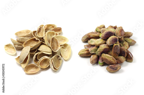 a handful of salted pistachio nut shell pistachios