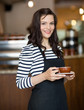 Attractive Waitress Holding Coffee Cup In Cafeteria