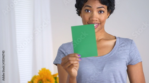 African American woman asking which color to paint room