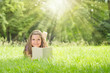 Girl on the Gras reading Book and Rays of Light coming down