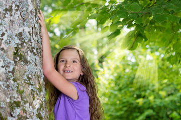 Girl under Tree with Ray of Lights