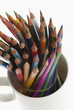Close-up of colored pencils in a desk organizer
