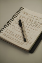 Close-up of a pen on an open notebook