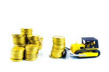 Raupe schiebt Geldstapel