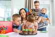 Family And Children Celebrating Birthday At Home