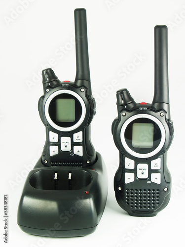 Two black portable radio set on the light background