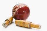 Close-up of a cricket ball and bails