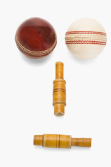 Cricket balls and bails forming a human face