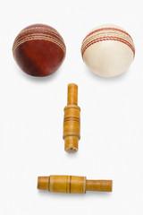 Cricket balls and bails forming an anthropomorphic face