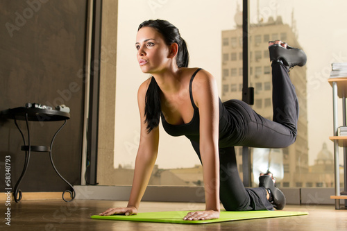 Beautiful woman exercising at home