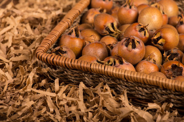 Medlar Fruits in Tray on Wooden Board