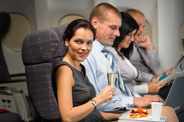 Business travel by plane woman enjoy refreshment