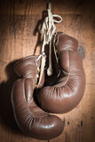 old Boxing Gloves, hanging on wooden wall