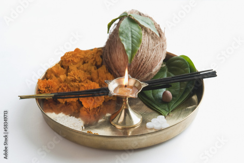 Close-up of religious offerings in a thali
