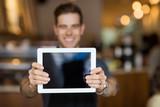 Cafe Owner Showing Digital Tablet