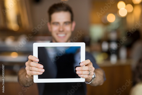Cafe Owner Showing Digital Tablet
