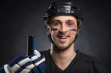 Funny hockey player smiling with one tooth missing.