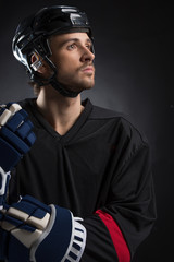 Serious hockey player looking away.