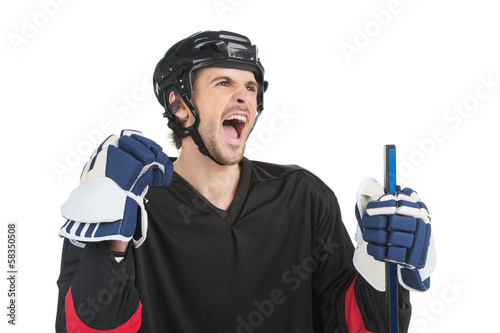 Close up of screaming hockey player.