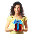 Beautiful brunette woman holding a gift. Isolated on white