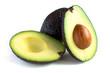 A fresh avocado cut in half - 58353311