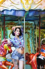 Amusement Park. Attractive Woman in Fanfair on Arcade