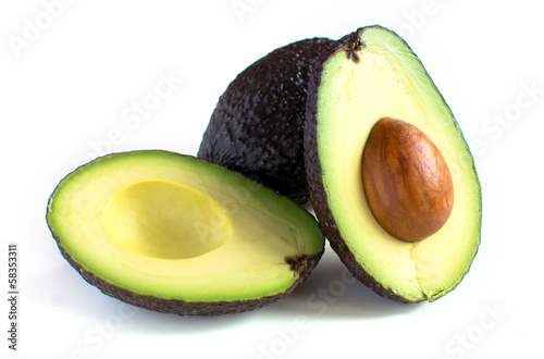A fresh avocado cut in half © grounder