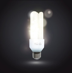 Realistic lightbulb isolated over black.