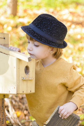 Child Looking Curious at one Birds House