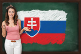 Beautiful and smiling woman showing flag of Slovakia on blackboa