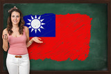 Beautiful and smiling woman showing flag of Republic of China on